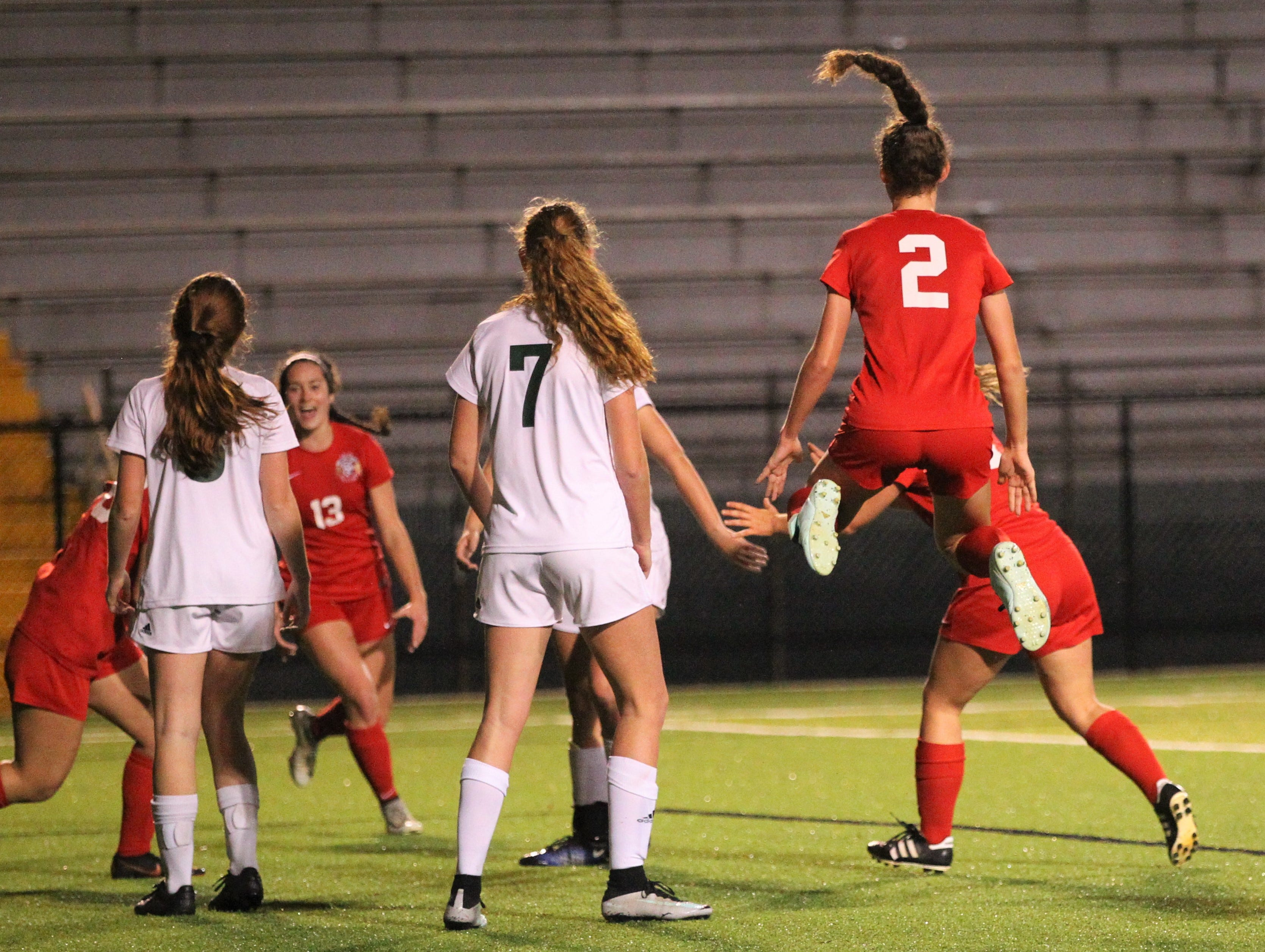 Leon's Melody Hughes reacts to Eden Kirn's header goal off a corner kick that proved the game-winner as Leon's girls soccer team beat Lincoln 2-1 in the District 2-4A championship at Gene Cox Stadium on Feb. 1, 2019.