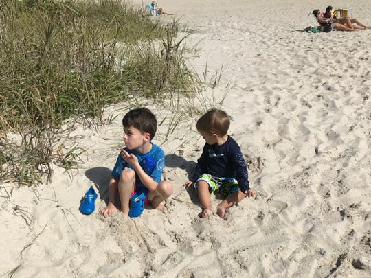 Declan, 6, and Benjamin, 2, Kilpatrick of North Carolina spent their South Beach visit digging in the sand instead of swimming because of high levels of bacteria in the water.