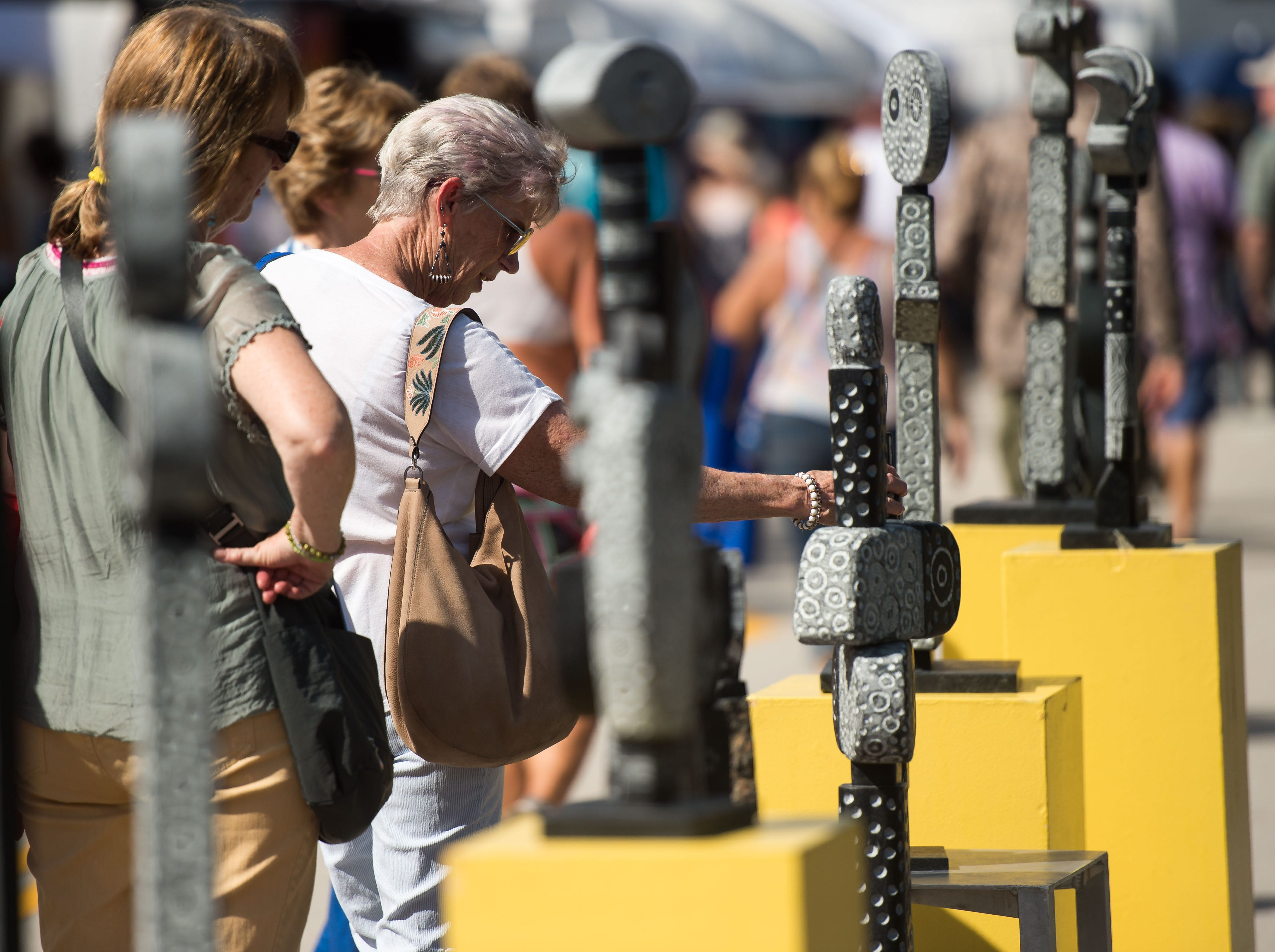 Artists and vendors line Dixie Highway from Bridge Road to Venus Street at the 18th annual Hobe Sound Festival of the Arts on Saturday, Feb. 2, 2019, in Hobe Sound. The free outdoor event, which features top artists and skilled craft artisans from around the country, continues from 10 a.m. to 5 p.m. on Sunday.