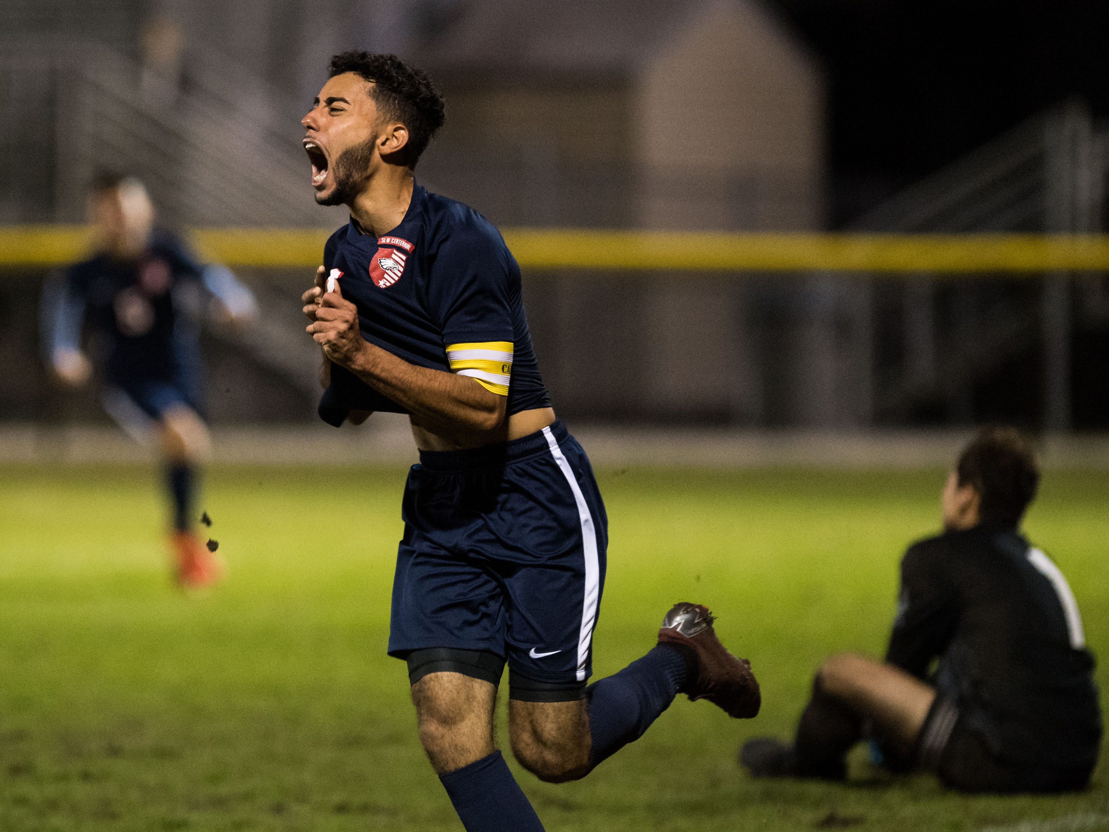 St. Lucie West Centennial's Rian Jamai celebrates scoring the game-winning goal with two minutes left in the second half against Jupiter during the high school boys soccer District 10-5A championship Friday, Feb. 1, 2019, at South County Regional Stadium in Port St. Lucie.