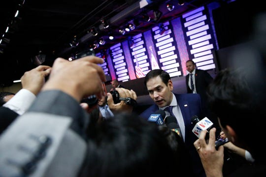 Sen. Marco Rubio speaks to the media after a rally about the political crisis in Venezuela on Friday, Feb. 1, 2019, in Doral, Fla.