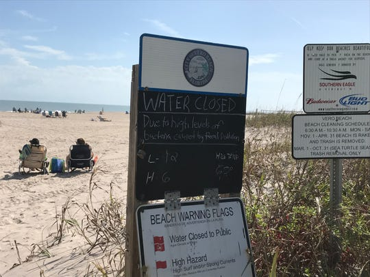 Beach closed signs were placed three county beaches, including this one at South Beach, alerting swimmers of the high levels of bacteria in the water.