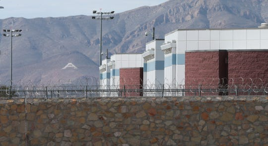 A rock wall and barbed wire seal off the U.S. Immigration and Customs Enforcement El Paso Processing Center at 8915 Montana Ave.