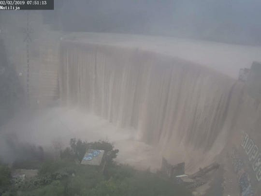 Heavy flow over Matilija Dam Saturday morning as a rainstorm soaked Ventura County.