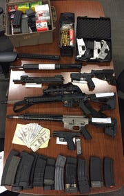 Firearms, magazines, ammunition and counterfeit cash were seized by Camarillo authorities when a search warrant was served Wednesday.