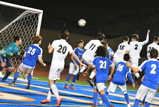 Senior Jack Fitzpatrick (2) heads in a Newbury Park goal at Westlake on Tuesday. The Panthers open the Division 2 playoffs at home against St. Francis.