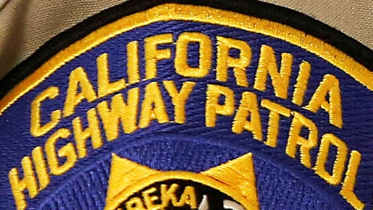 This file photo shows a shield on the uniform of a California Highway Patrol officer at the state Capitol in Sacramento.