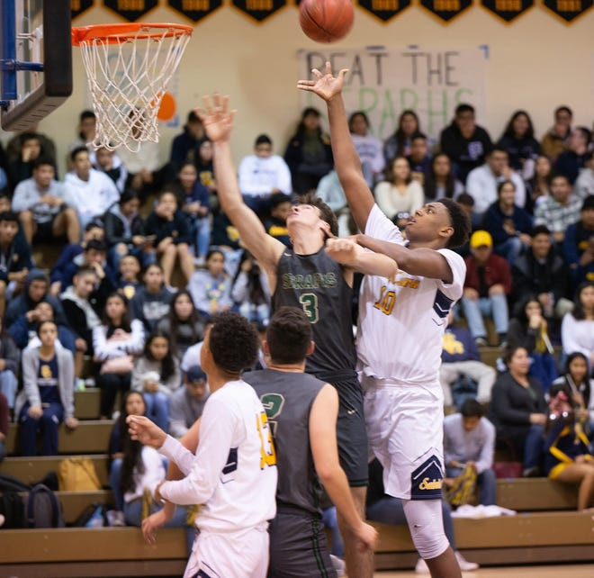 Christian Oliver, shown in a game earlier this season, finished with 23 points and 16 rebounds to help Santa Clara reach the 5AA semifinals.