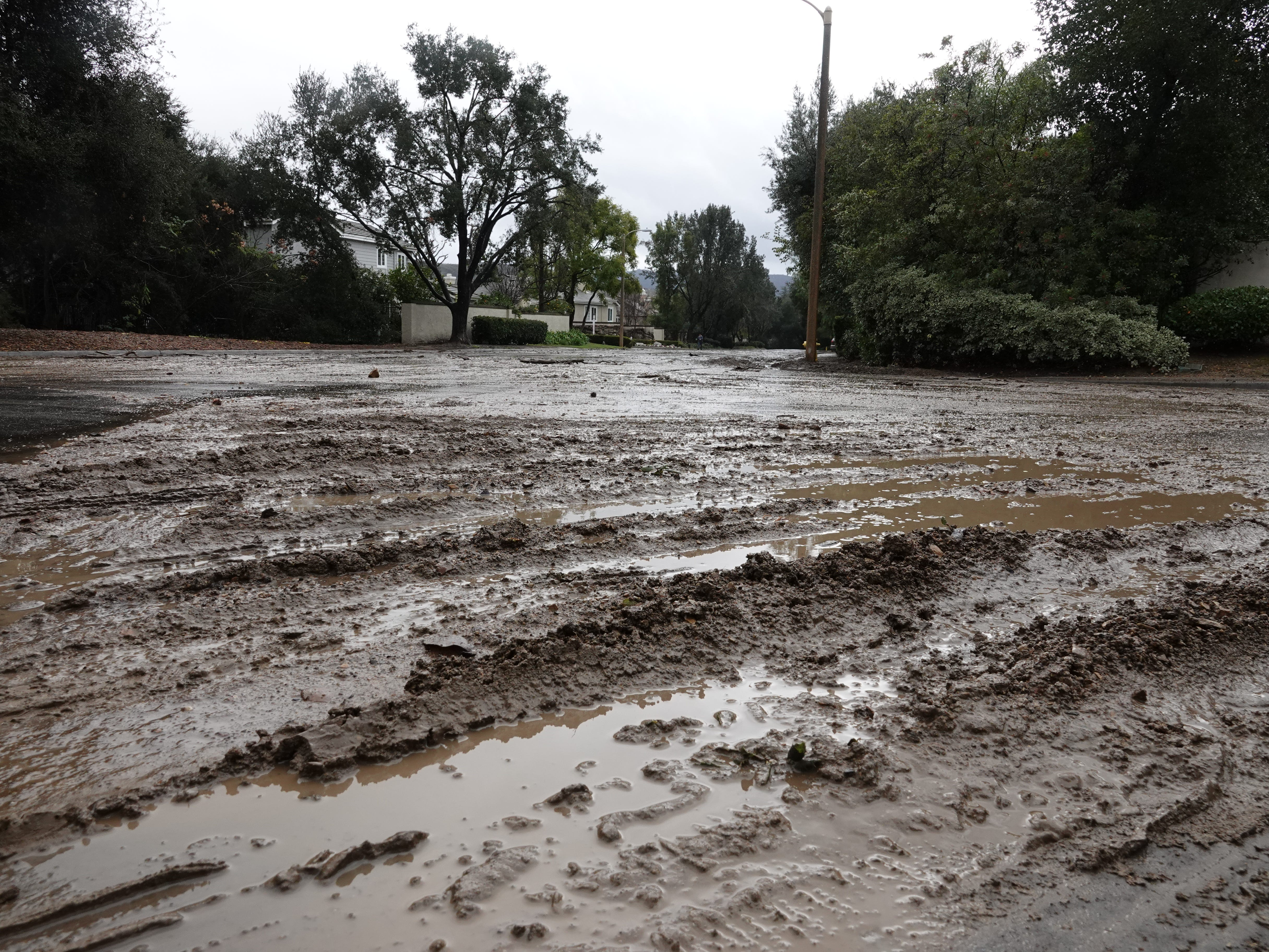 Mud seeped onto residential streets in many parts of Ventura County Saturday, including the intersection of Bowfield and Rockfield streets in the North Ranch area of Thousand Oaks.
