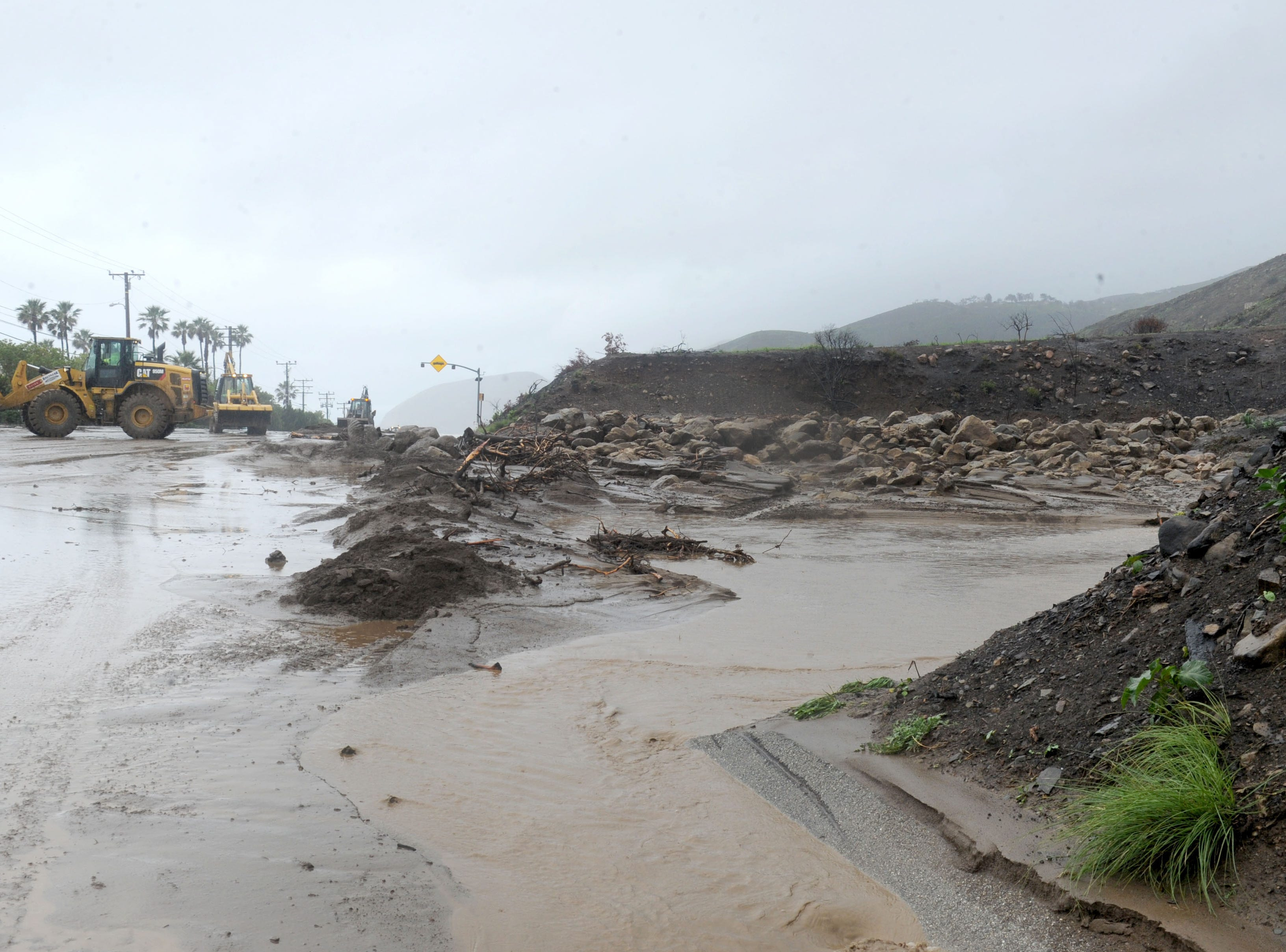 Saturday's storms brought these rocks down a canyon close to the Malibu Bay Club on Pacific Coast Highway. The storm closed the highway near Leo Carrillo State Beach.