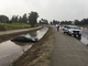 Oxnard police helped rescue a woman driving a car that hydroplaned into a ditch on Victoria Avenue Saturday morning.