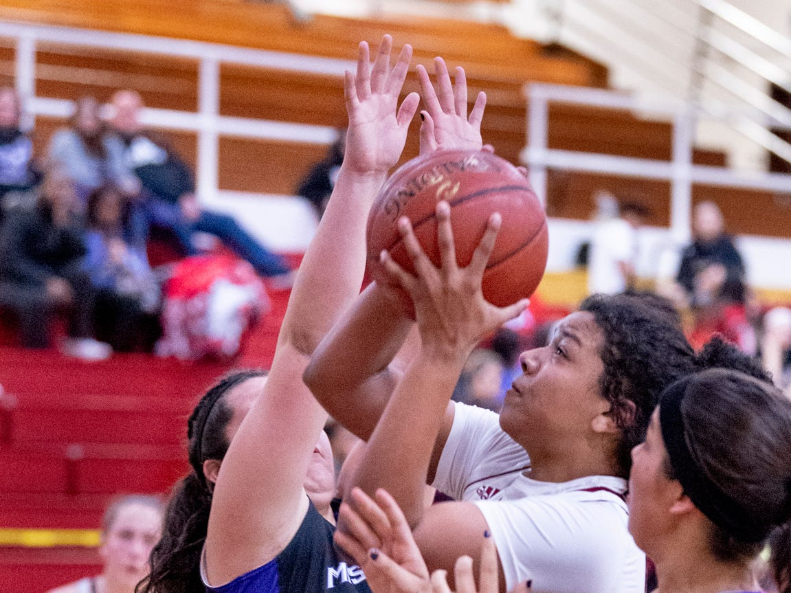 Tulare Union's Kiara Brown goes up for two between Mission Oak's Kayleigh Lopes, right, and Alyssa Logan in a girls basketball game on Friday, February 1, 2019.