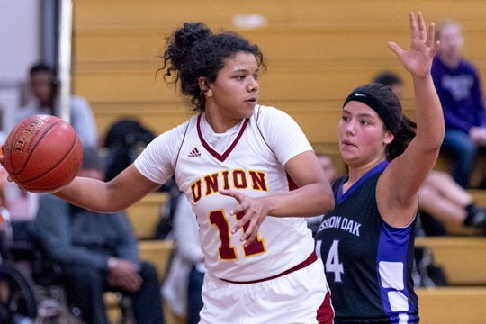 Tulare Union's Kiara Brown passes under pressure from Mission Oak's Kayleigh Lopes in a girls basketball game on Friday, February 1, 2019.