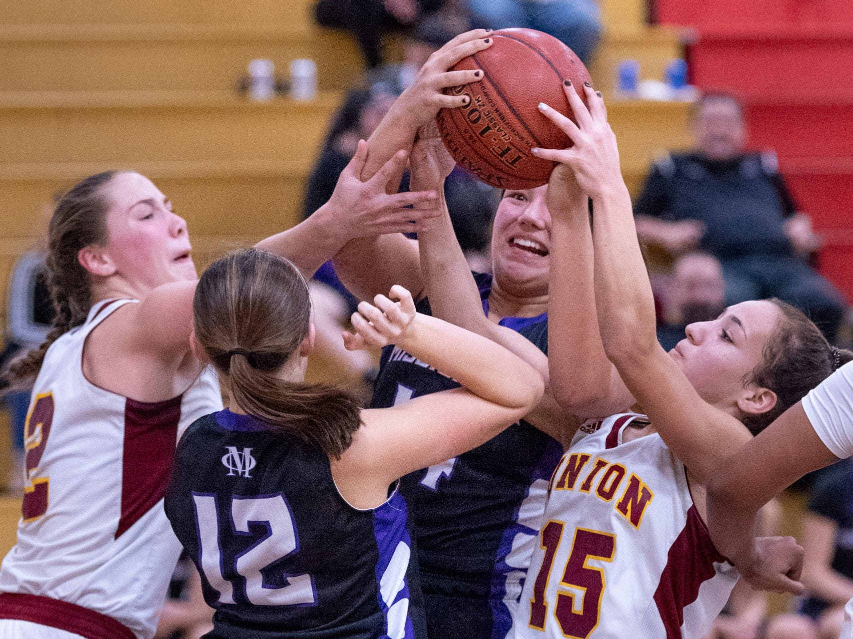 Tulare Union's Morgan Hatton, left, Mission Oak's Kailey Silva (12), Mission Oak's Kayleigh Lopes and Tulare Union's Brissa Allen go for a rebound in a girls basketball game on Friday, February 1, 2019.