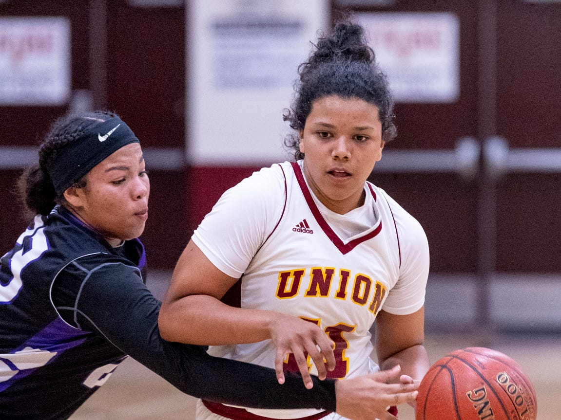 Mission Oak's Gabby Matlock, left, pressures Tulare Union's Kiara Brown in a girls basketball game on Friday, February 1, 2019.