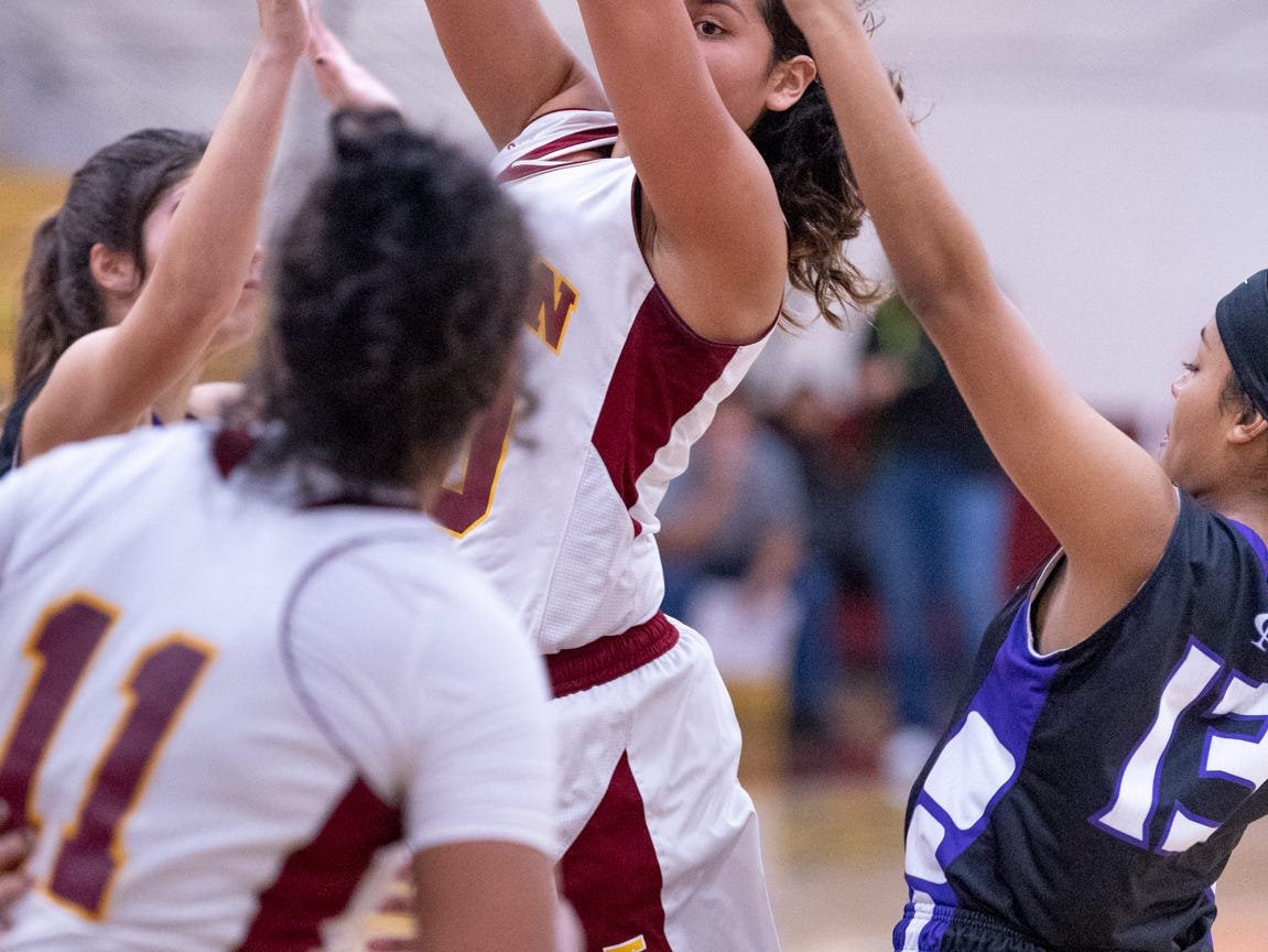 Tulare Union's Vivaca Gonzales passes to Kiara Brown against Mission Oak in a girls basketball game on Friday, February 1, 2019.