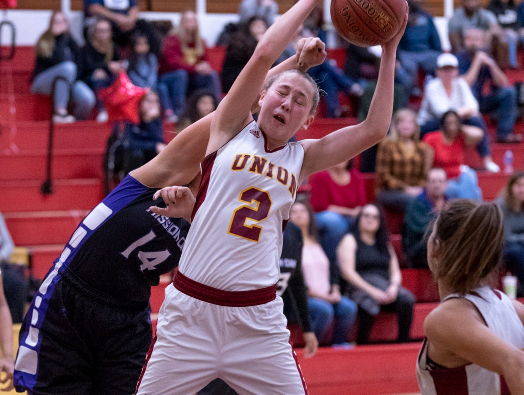 Mission Oak's Kayleigh Lopes, left, and Tulare Union's Morgan Hatton go up for a rebound in a girls basketball game on Friday, February 1, 2019.