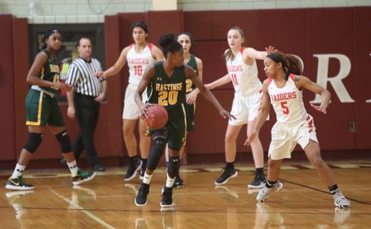 Hastings' Melannie Daley (20) works the ball as North Rockland's Olivia Levy (5) defends during the Pauline Ricci Memorial Scholarship Classic basketball tournament at Ossining High School on Saturday, February 2, 2019.