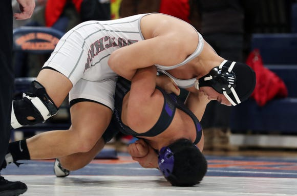 Tappan Zee's Paul Lee on his way to defeating New Rochelle's Sebastian Lujan in the 220-pound weight class during the divisional qualifier at Horace Greeley High School in Chappaqua Feb. 2, 2019.