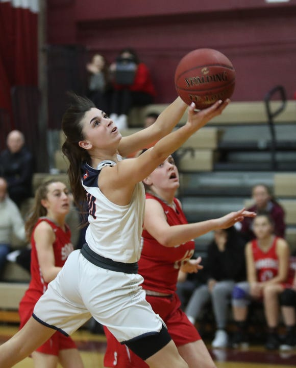 Briarcliff's Kacey Hamlin (00) works a shot through the Somers defense during the Pauline Ricci Memorial Classic basketball tournament at Ossining High School on Saturday, February 2, 2019.