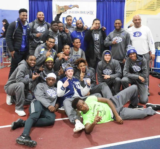 Dover celebrates its boys state team title during the DIAA state indoor track championships in Landover, Md., on  Saturday.