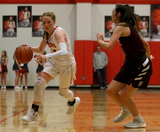 Holliday's Sarah Cowan dribbles by Bowie's Aslyn Davis Friday, Feb. 1, 2019, in Holliday. The Lady Rabbits defeated the Lady Eagles 43-35.