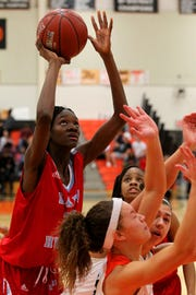 Hirschi's Niara Hightower takes a shot Friday in the Lady Huskies' district-clinching win.