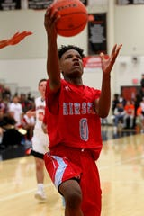 Hirschi's Ernest Young attempts a layup Friday night in Burkburnett's 61-49 win.