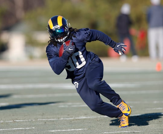Los Angeles Rams running back Todd Gurley (30) runs the ball during practice for the NFL Super Bowl 53 football game against the New England Patriots, Thursday, Jan. 31, 2019, in Flowery Branch, Ga. (AP Photo/John Bazemore)