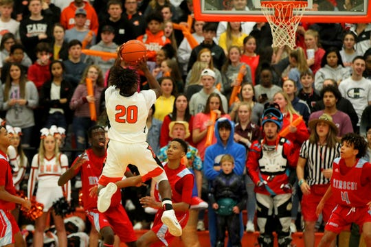 Burkburnett's KenDarius Horton attempts a shot in front of the Bulldogs' student section Friday night against Hirschi.