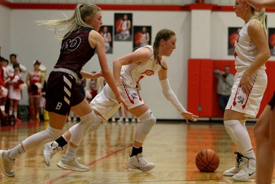 Holliday's Sarah Cowan dribbles by Bowie's Jayci Logan Friday, Feb. 1, 2019, in Holliday. The Lady Rabbits defeated the Lady Eagles 43-35.