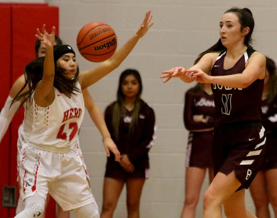 Bowie's Aslyn Davis passes in the game against Holliday Friday, Feb. 1, 2019, in Holliday. The Lady Rabbits defeated the Lady Eagles 43-35.