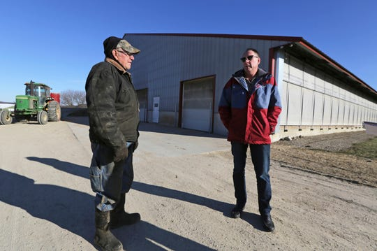 "Randy Roecker, right, talks with his father, Gerald, on his farm in Loganville, Wis., Wednesday, Jan. 16, 2019. Roecker said he became suicidal in 2008, when the recession hit, after investing millions to expand the farm started by his grandfather in the 1930s. ""I felt like I was losing the farm, a generational farm,"" he said. ""This plays with your mind so bad. It is overwhelming."""