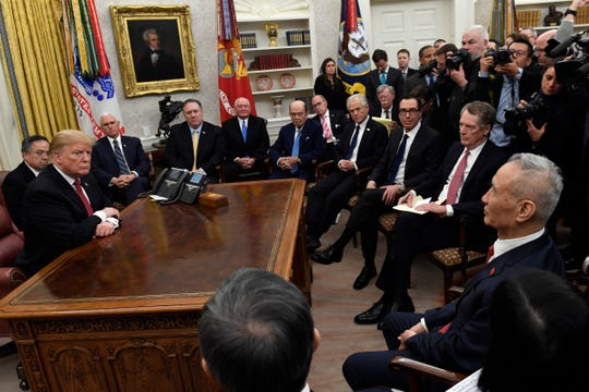 President Donald Trump, left, meets with Chinese Vice Premier Liu He, front right, at the White House in Washington, Thursday, Jan. 31, 2019.