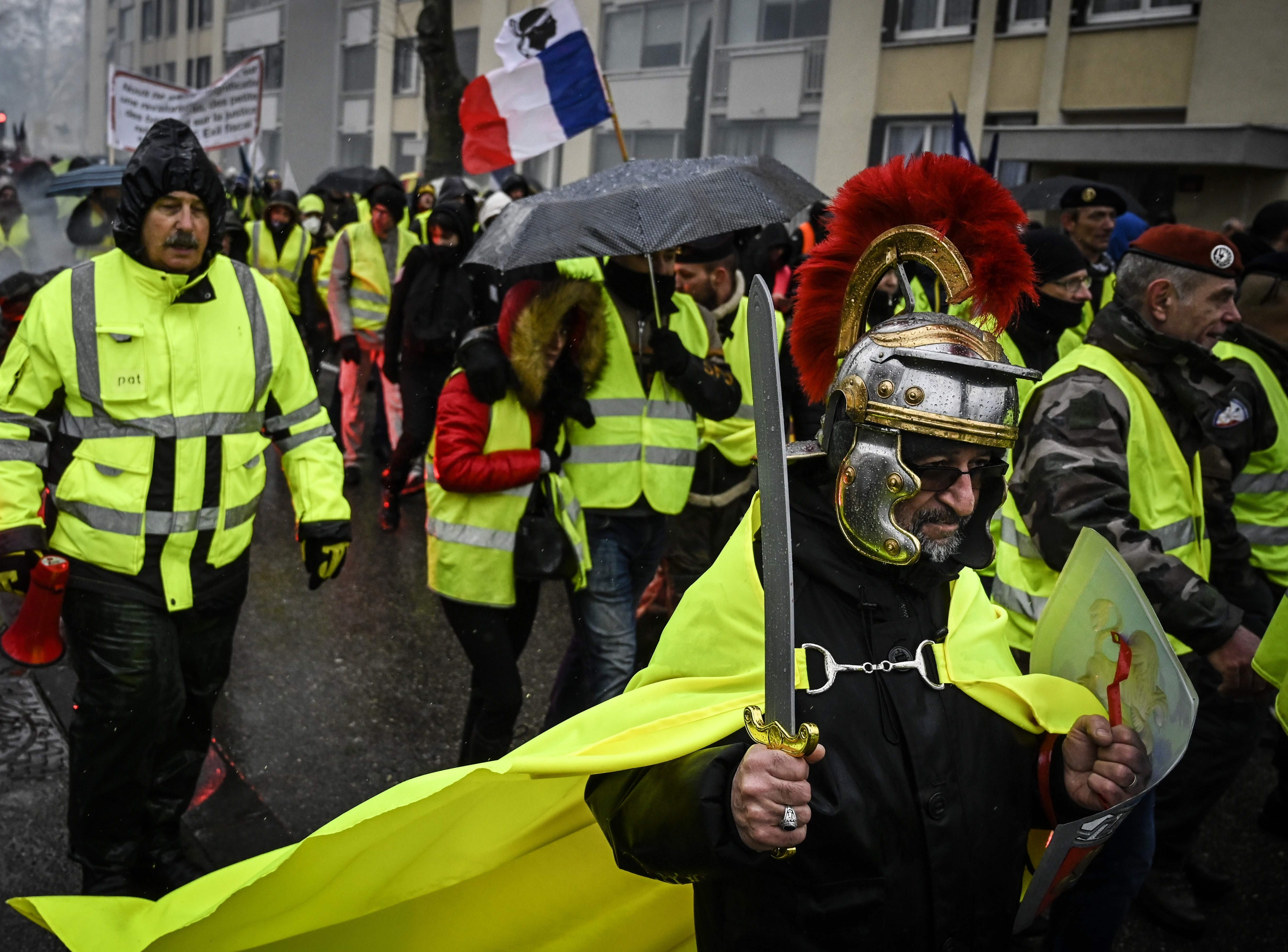 Protestors march while taking part in an anti-government demonstration called by the Yellow Vests  movement in Valence, south-eastern France on Feb. 2, 2019.