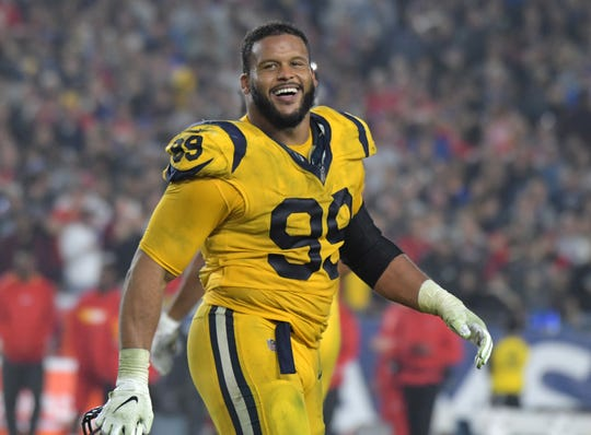 Los Angeles Rams defensive end Aaron Donald (99) celebrates in the fourth quarter against the Kansas City Chiefs at the Los Angeles Memorial Coliseum.