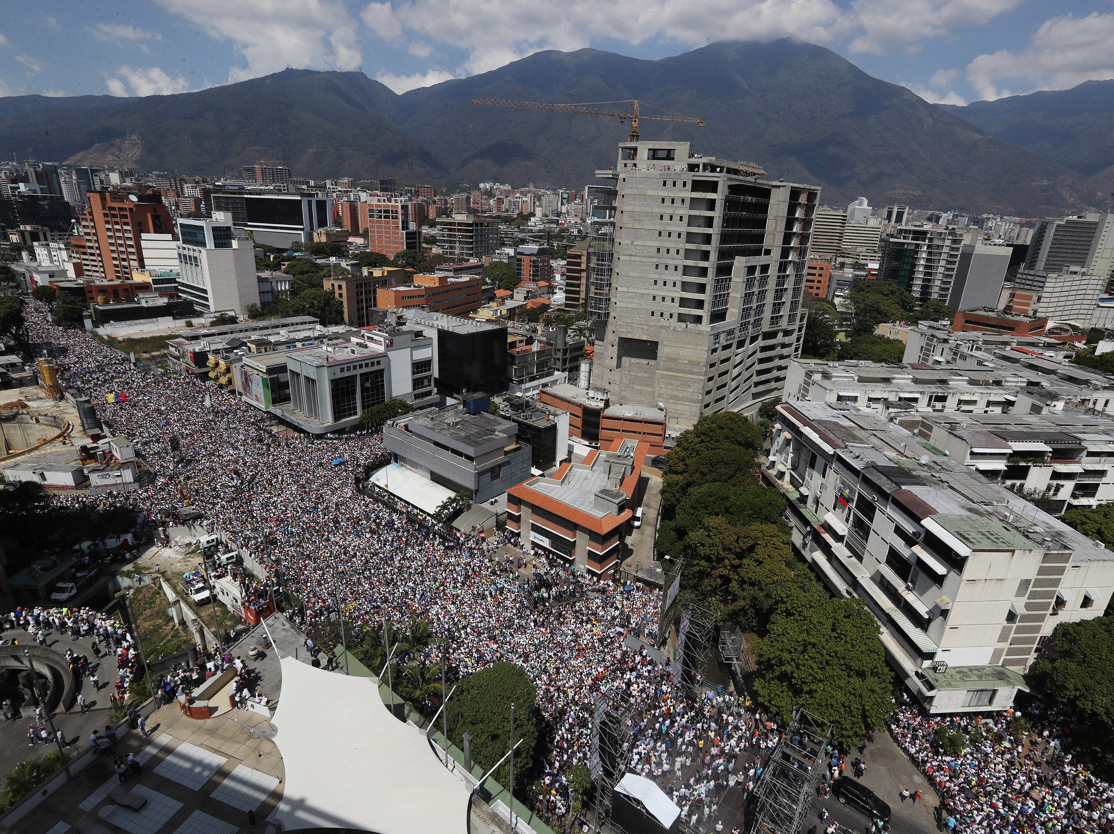 Thousands of sympathizers of the Venezuelan opposition participate in a march against Nicolas Maduro's Government, in Caracas, Venezuela on Feb. 2, 2019. Maduro and his opponent National Assembly leader Juan Guaido have called on their supporters to take to the streets as international pressure increased on Maduro to resign. Guiado had declared himself interim president of Venezuela on January 23 and promised to guide the country toward new election as he consider last May's election not valid.