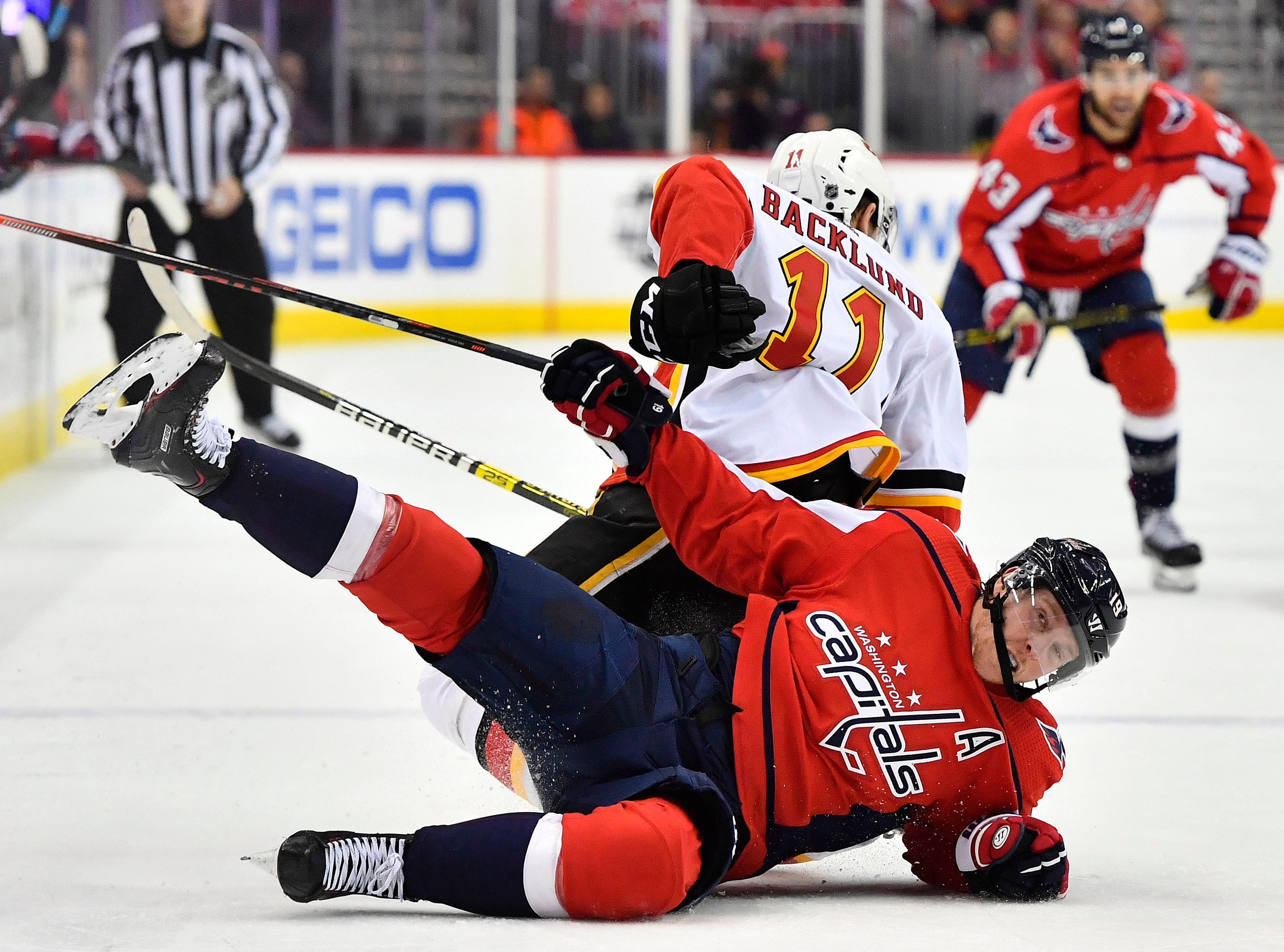 Feb. 1: Calgary Flames center Mikael Backlund (11) is assessed a penalty for tripping Washington Capitals center Nicklas Backstrom (19) during the third period at Capital One Arena.