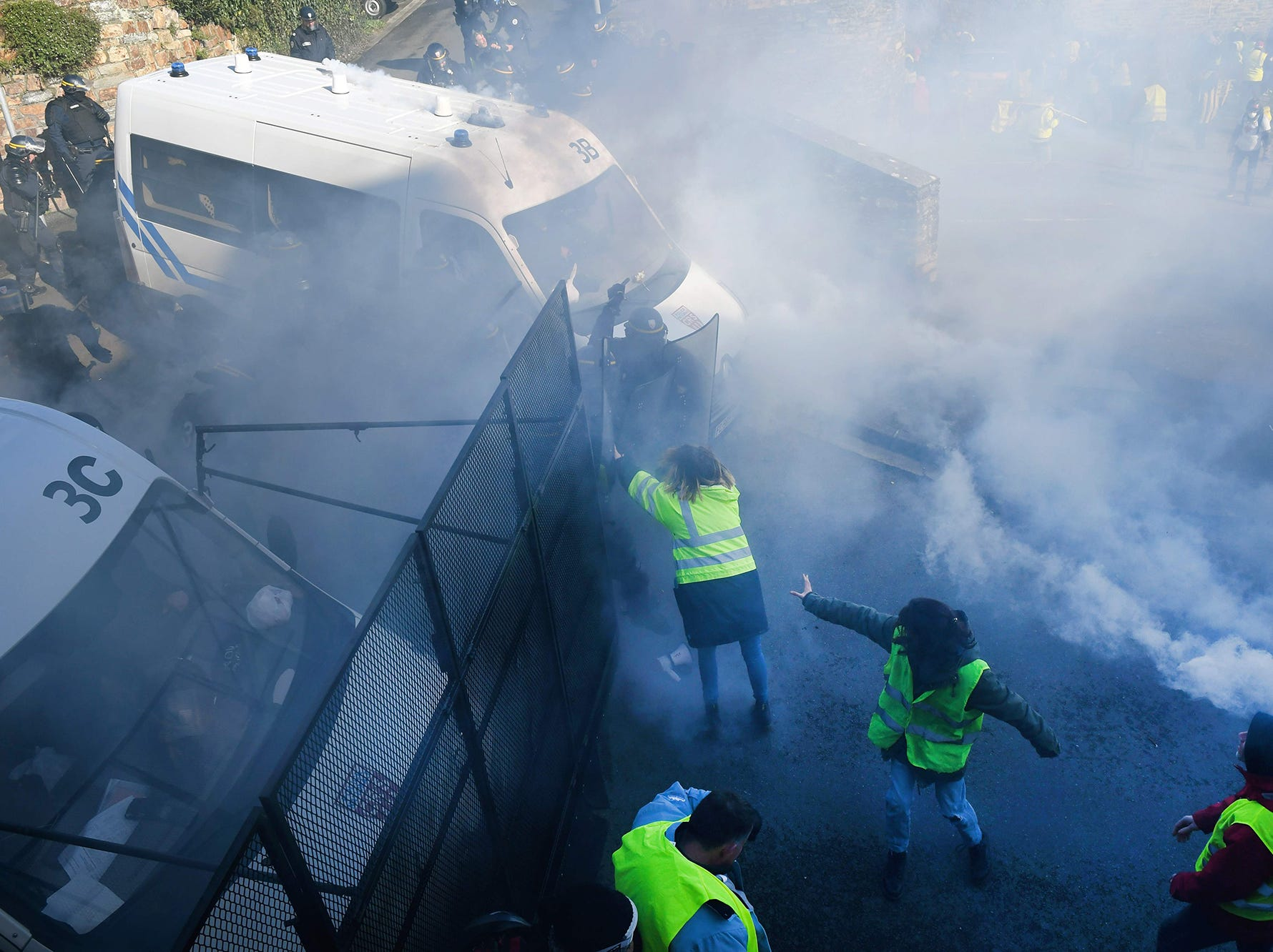 "Protestors are teargassed by authorities while taking part in an anti-government demonstration called by the Yellow Vests ""Gilets Jaunes"" movement in front of the sous-prefecture of Morlaix, western France on Feb. 2, 2019."