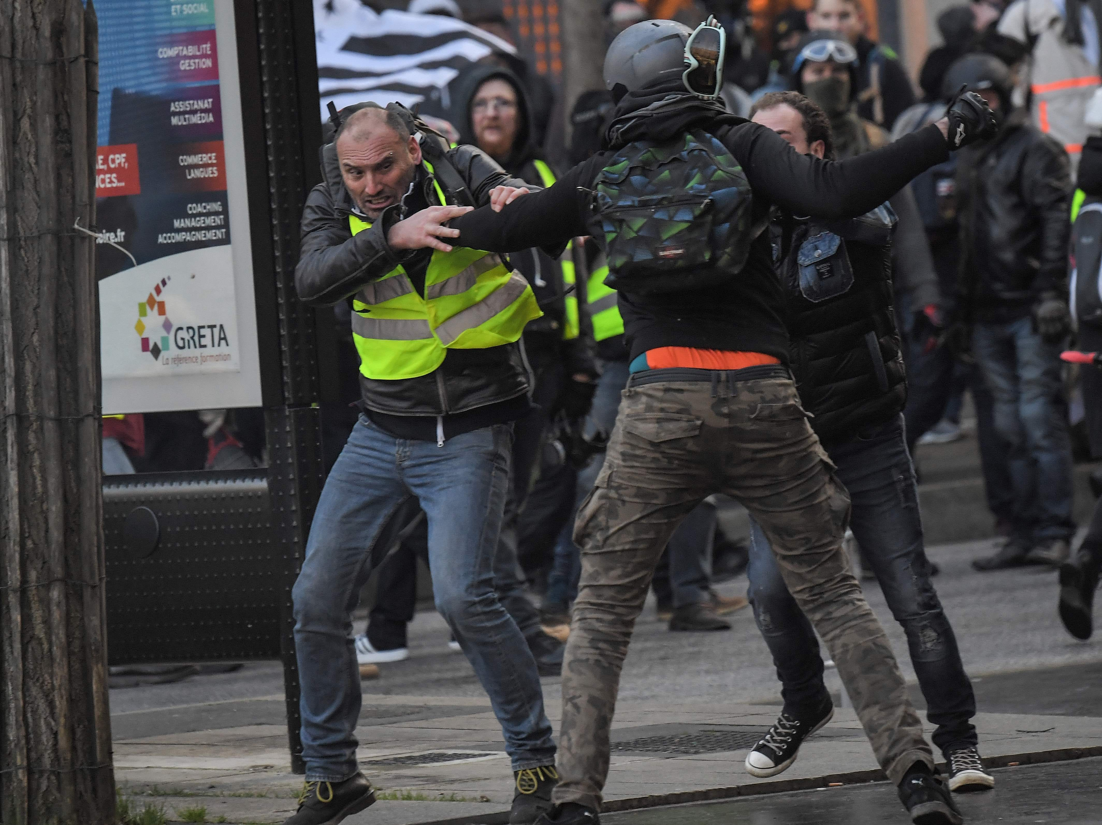 Factions of protestors fight against each others during a demonstration called by the 'Yellow Vests' ('Gilets Jaunes') movement in Nantes, western France, on Feb. 2, 2019.