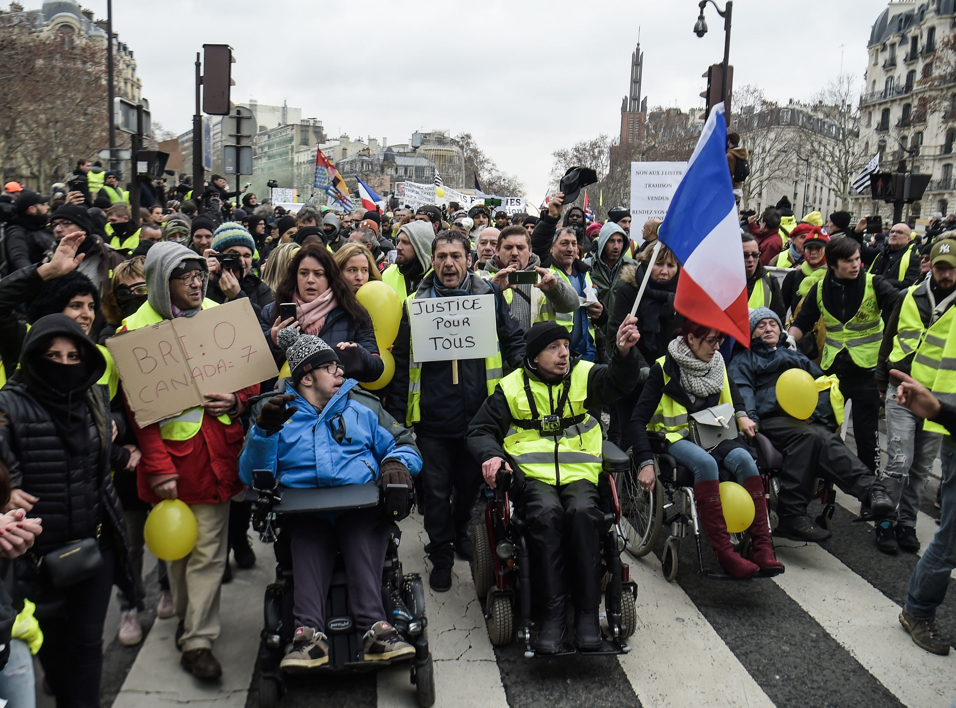 Protesters in a wheelchair take part in a march on Feb. 2, 2019 in Paris, called to pacifically protest against police violence toward participants of the last three months demonstrations in France, as Yellow Vest protesters take to the streets for the 12th consecutive Saturday.