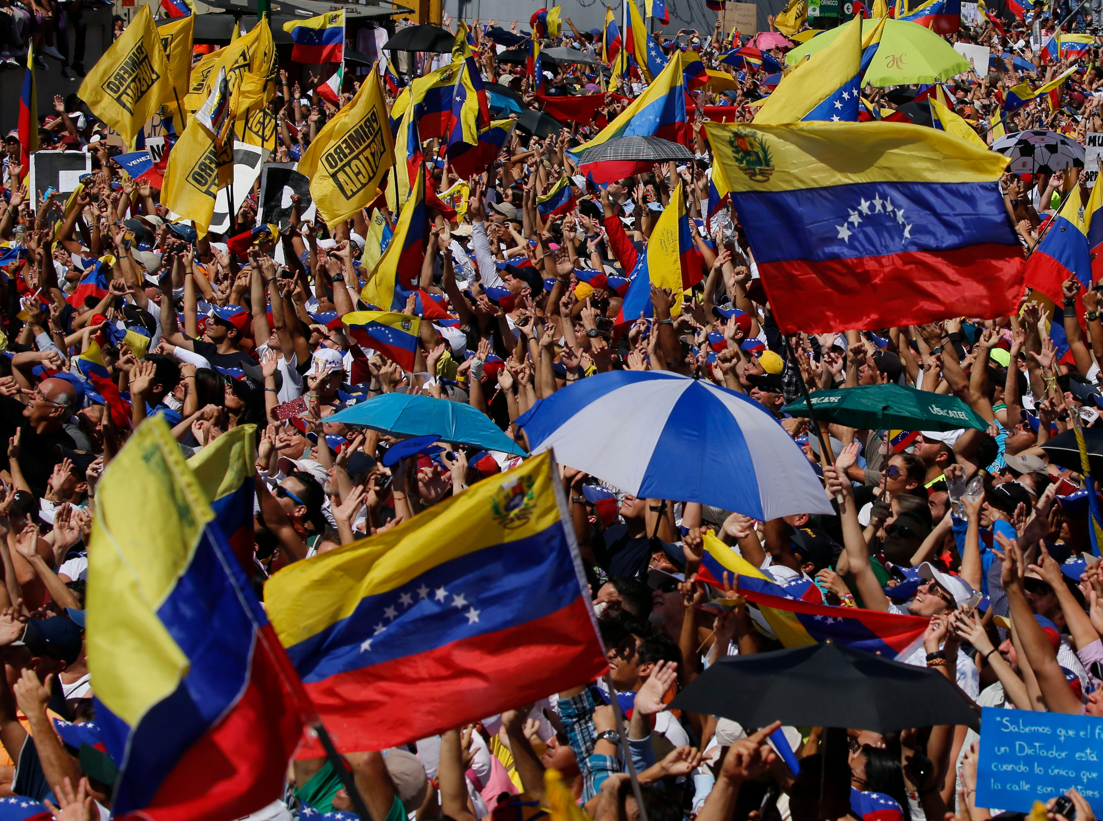 Anti-government protesters gather for the start of a nationwide demonstration demanding the resignation of President Nicolas Maduro, in Caracas, Venezuela, Saturday, Feb. 2, 2019.