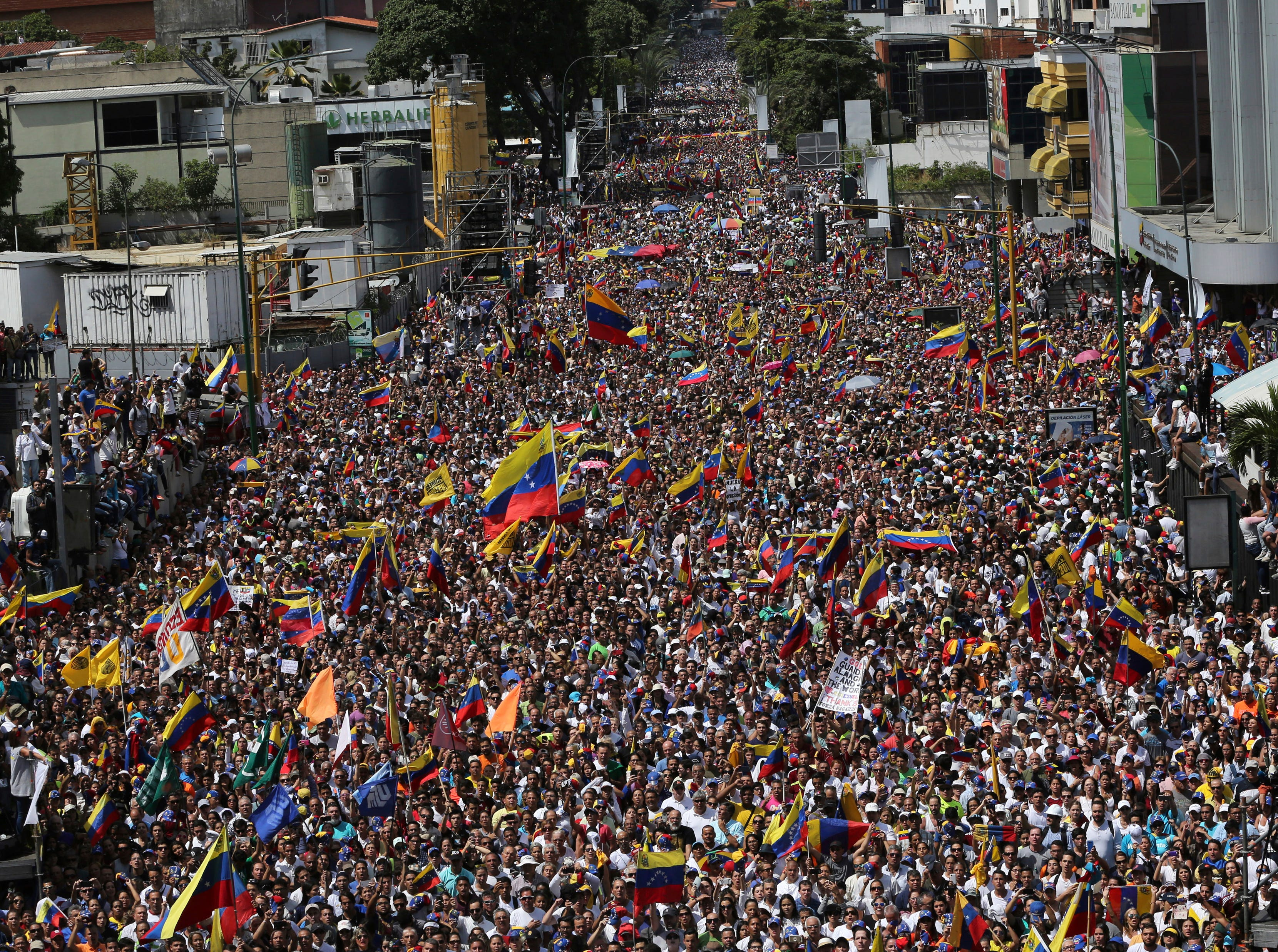 Anti-government protesters take part in a nationwide demonstration demanding the resignation of President Nicolas Maduro, in Caracas, Venezuela, Saturday, Feb. 2, 2019. Momentum is growing for Venezuela's opposition movement led by lawmaker Juan Guaido, who has called supporters back into the streets for nationwide protests Saturday, escalating pressure on Maduro to step down.