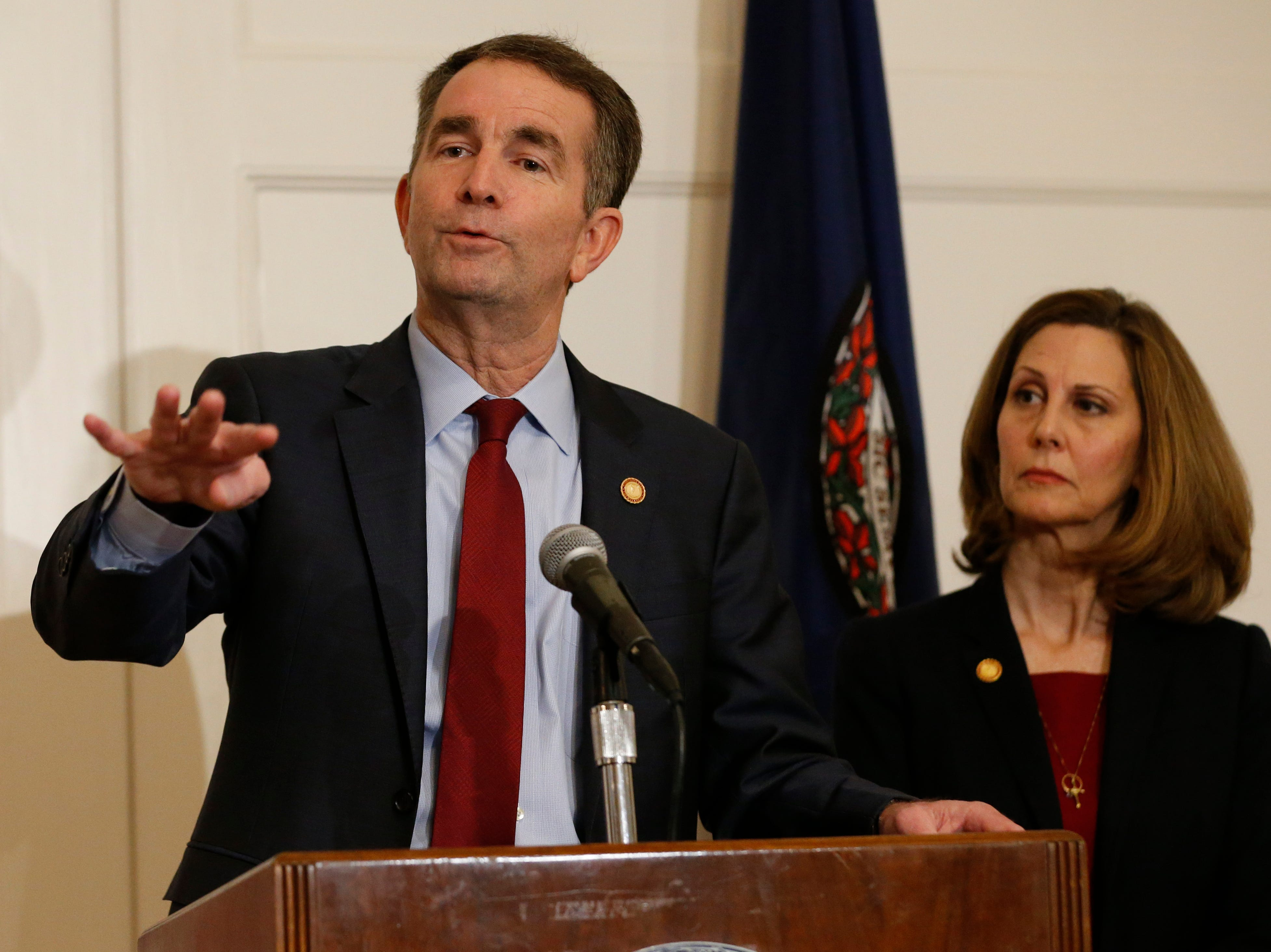 Virginia Gov. Ralph Northam, left, gestures as his wife, Pam, listens during a news conference in the Governors Mansion at the Capitol in Richmond, Va., Saturday, Feb. 2, 2019. Northam is under fire for a racial photo that appeared in his college yearbook.