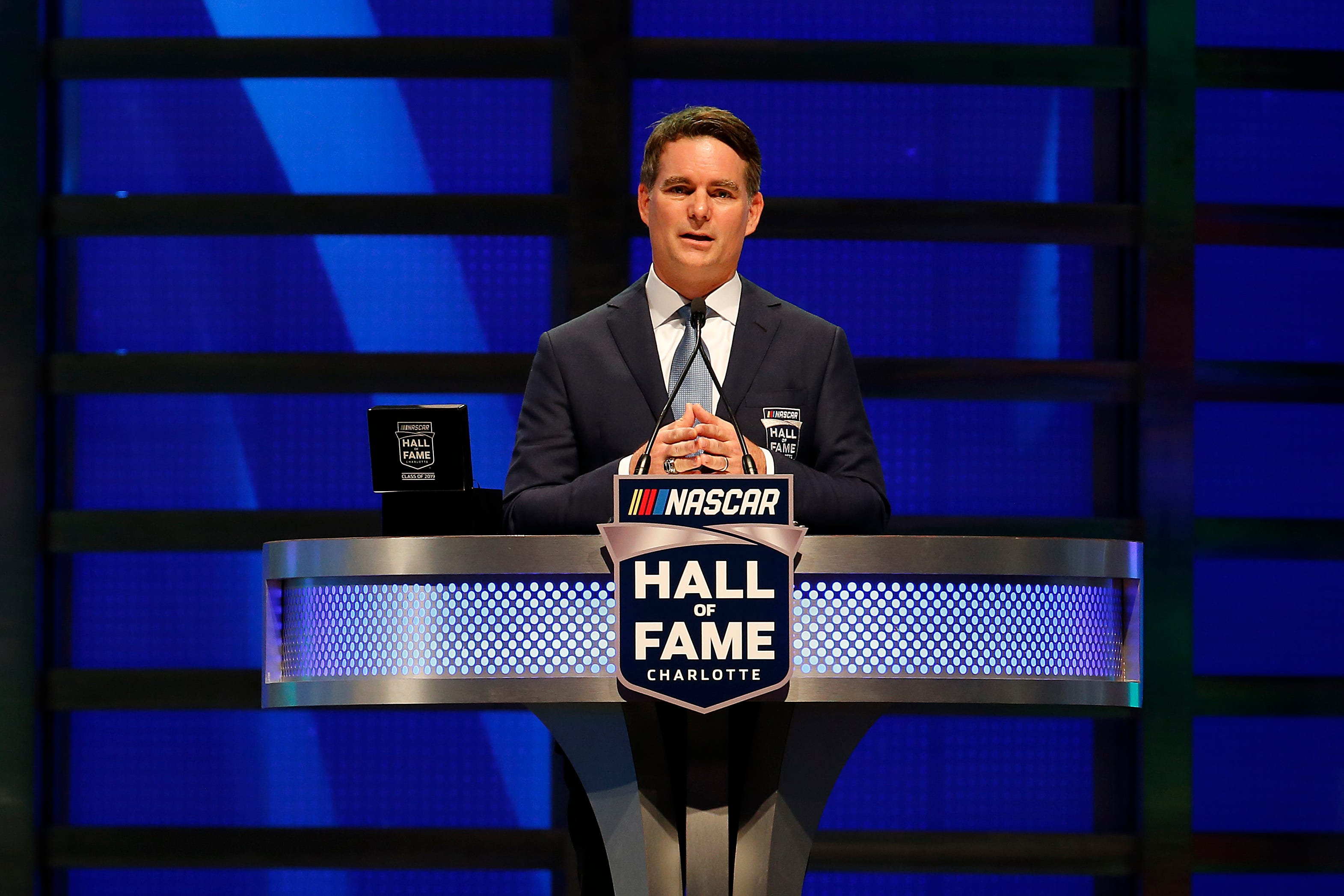 Jeff Gordon speaks on stage after being inducted into the NASCAR Hall of Fame.
