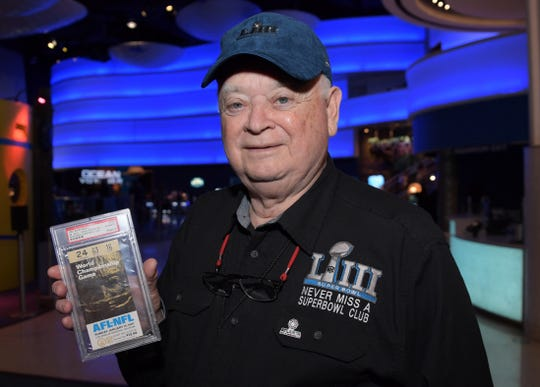 Don Crisman poses with a Super Bowl I ticket at Georgia Aquarium. Crisman has attended all 52 Super Bowls and will attend Super Bowl LIII Sunday.