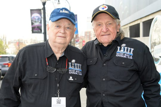 Don Crisman (left) and Tom Henschel pose at Georgia Aquarium. Crisman and Henschel have attended all 52 Super Bowls and will attend Super Bowl III on Sunday.