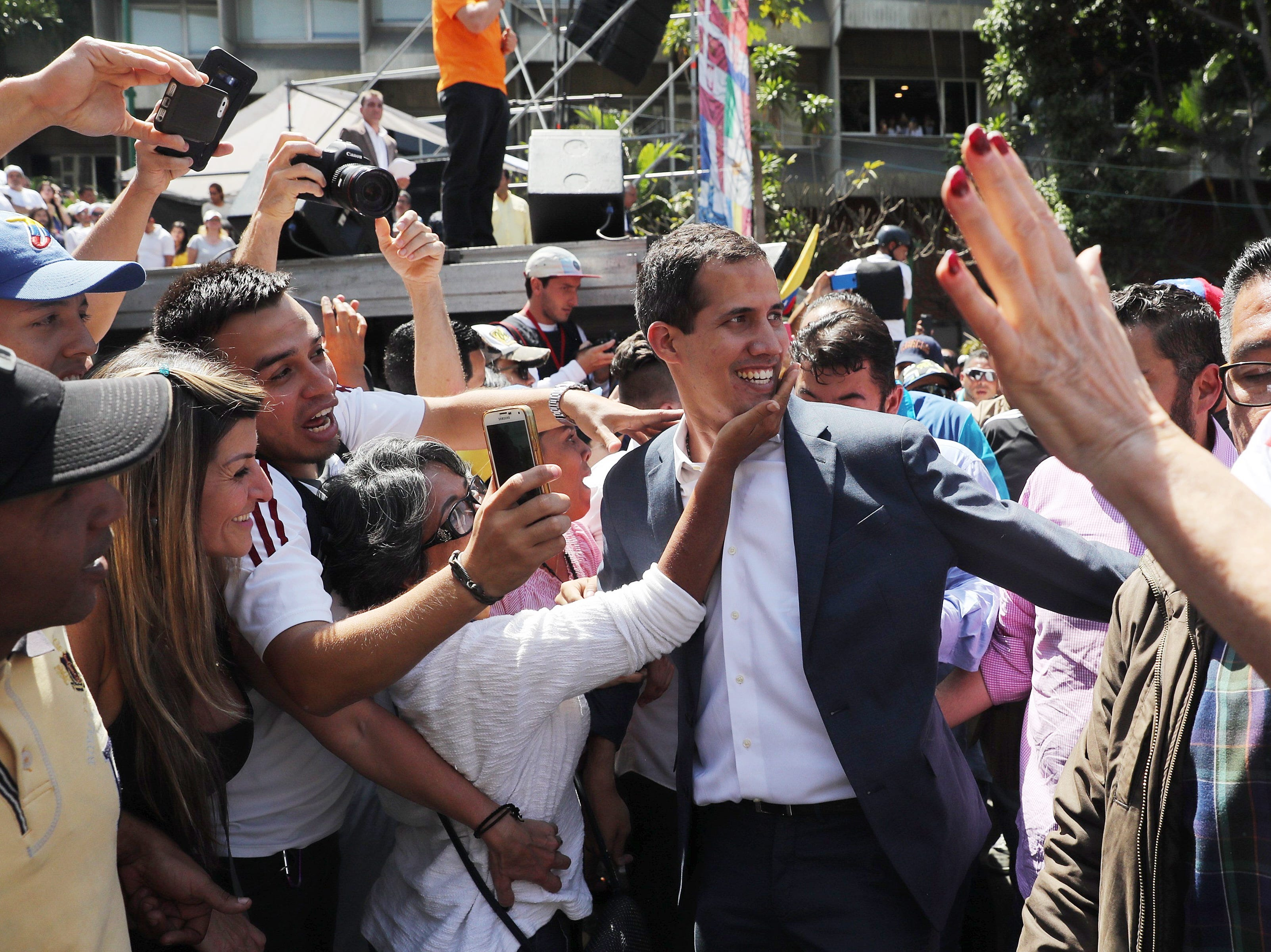President of the Venezuelan National Assembly Juan Guaido, center, arrives to deliver a speech during a march against Nicolas Maduro's Government, in Caracas, Venezuela on Feb. 2, 2019. Maduro and his opponent National Assembly leader Juan Guaido have called on their supporters to take to the streets as international pressure increased on Maduro to resign.