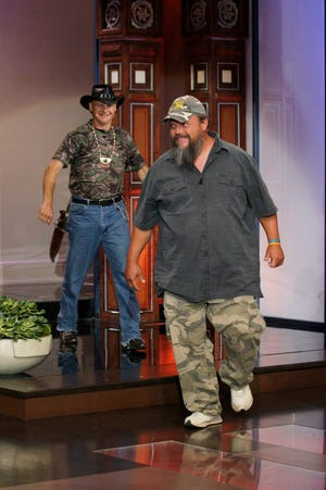 """Turtleman Ernie Brown, Jr. (L) and Neal James arrive (R) appear on """"The Tonight Show with Jay Leno"""" on June 13, 2012."""