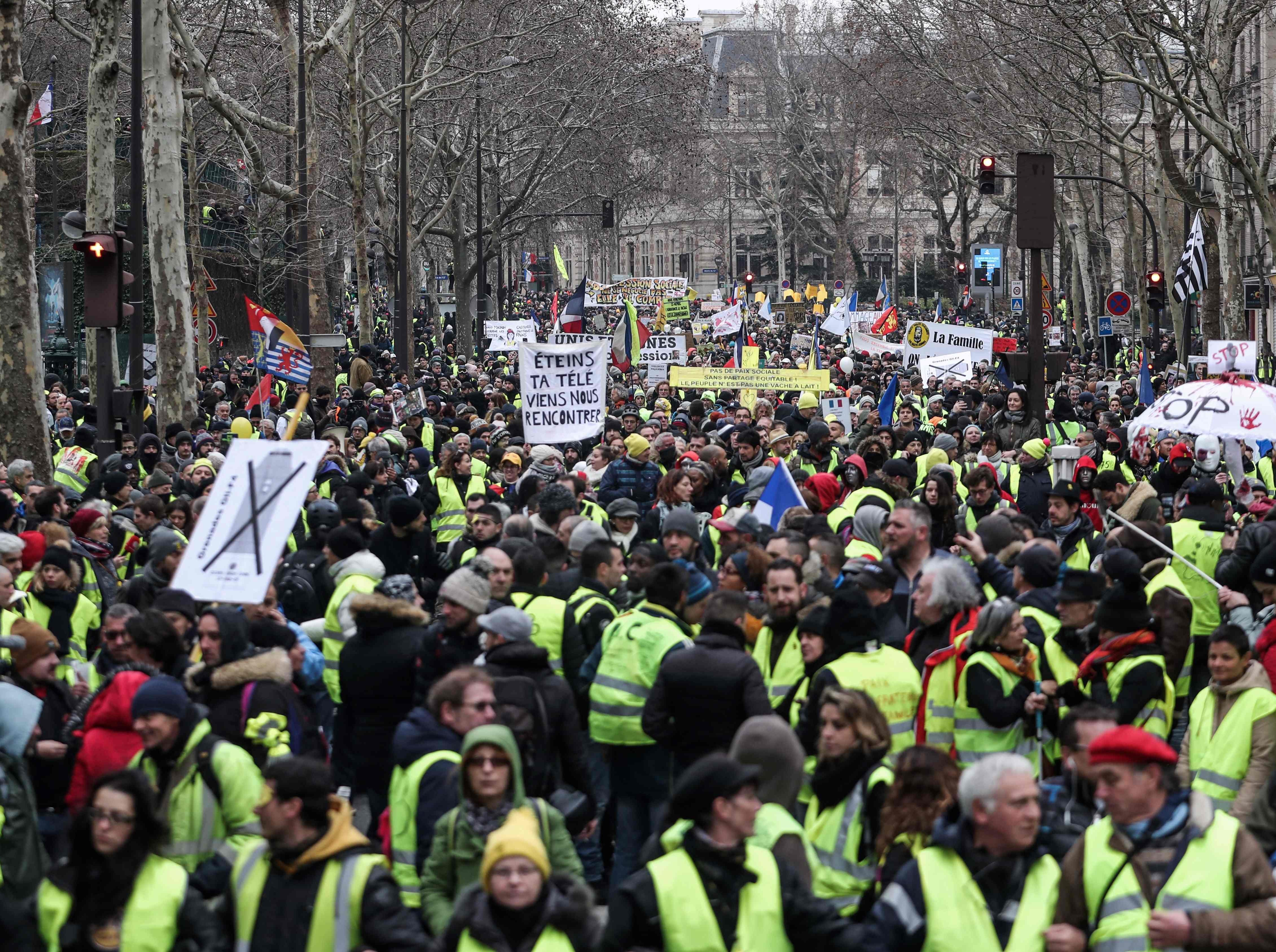 People take part in a march on Feb. 2, 2019 in Paris, called to pacifically protest against police violence toward participants of the last three months demonstrations in France and for the ban of the use by riot police of both 40-millimeter rubber defensive bullet launcher LBD and GLI-F4 stun grenades, as Yellow Vest protesters take to the streets for the 12th consecutive Saturday.